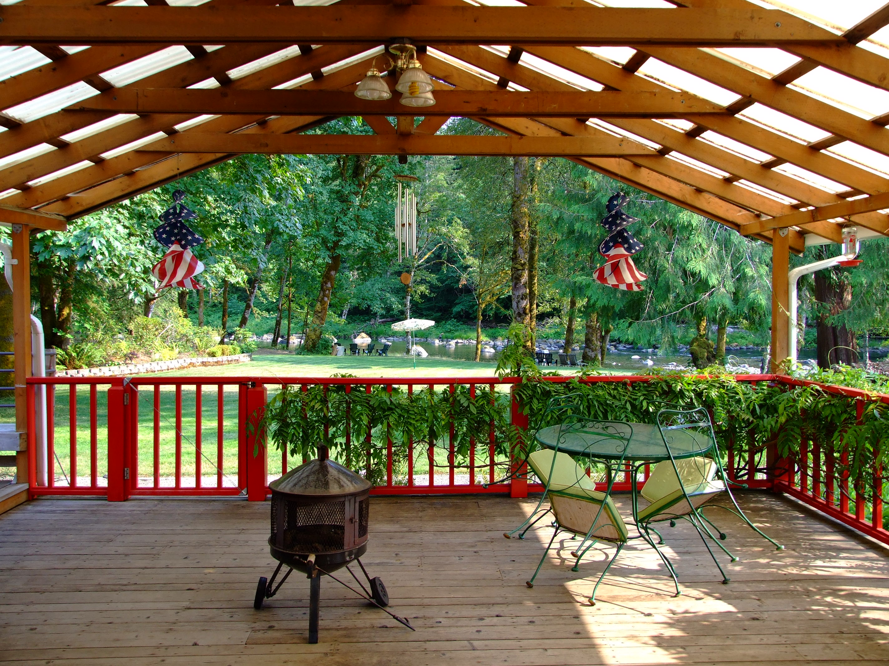 The view down to the river across the Cedar Breeze cabin deck. The hot tub is to the left. I'll have to use a wide angle lens next time.