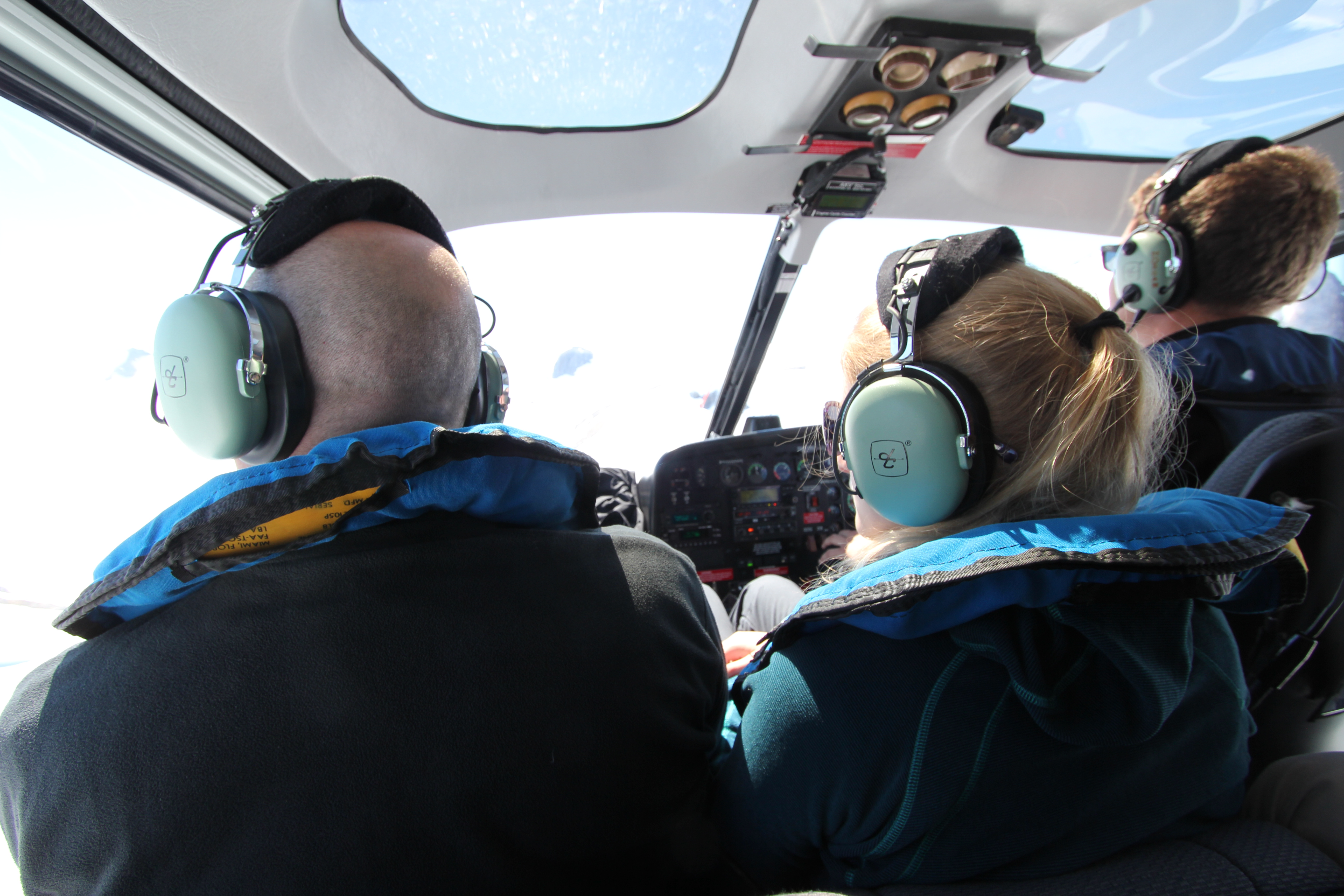 The pilot will allocate the exact seating arrangements for passengers based on a determination of weight and balance, so you fly in and fly out in the same seating position. You will be provided with flight headsets on boarding.