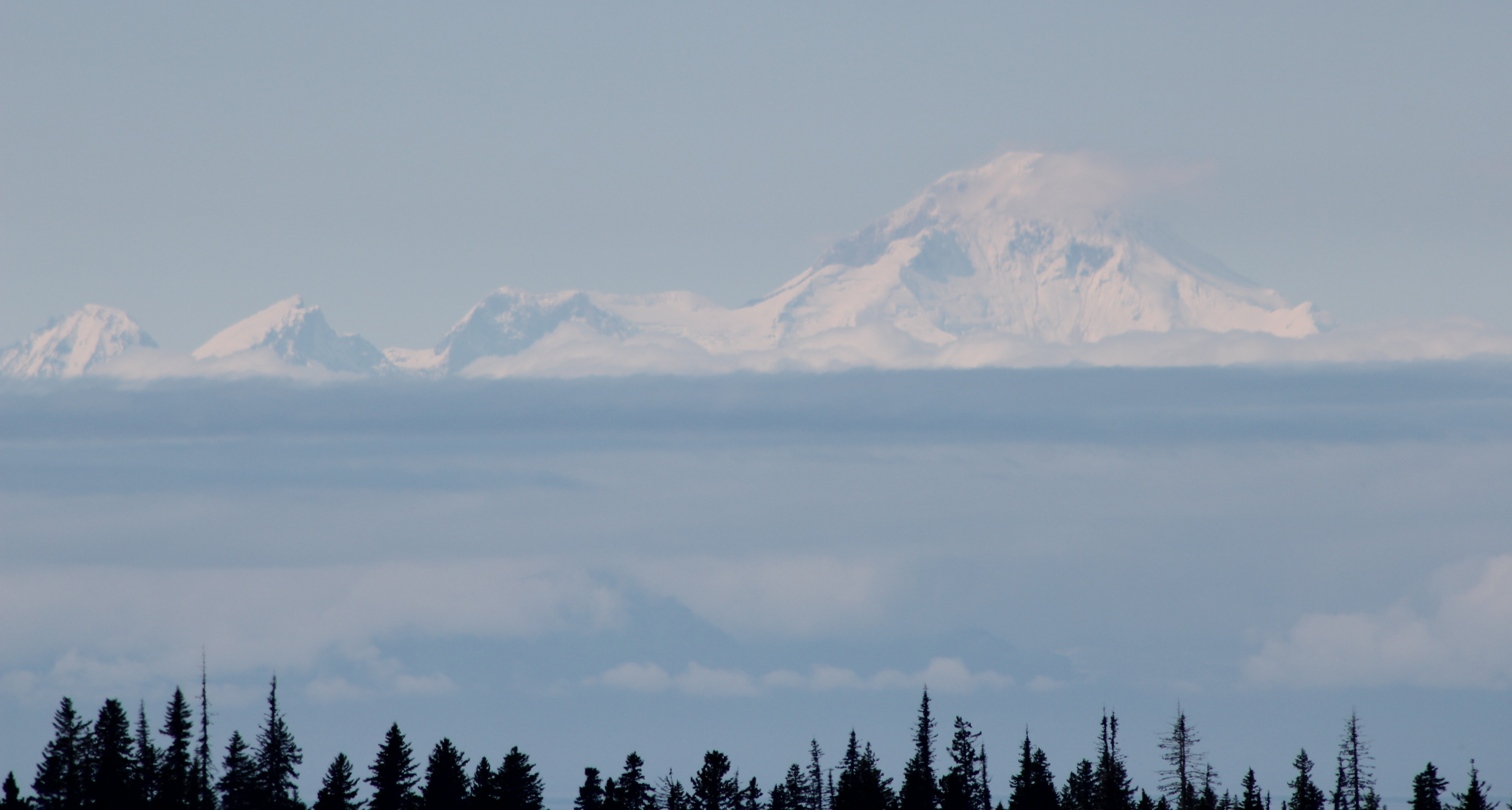 …but on our arrival day, and a bit further down the road towards Homer, the volcano was revealed through the clouds and haze of the distance.