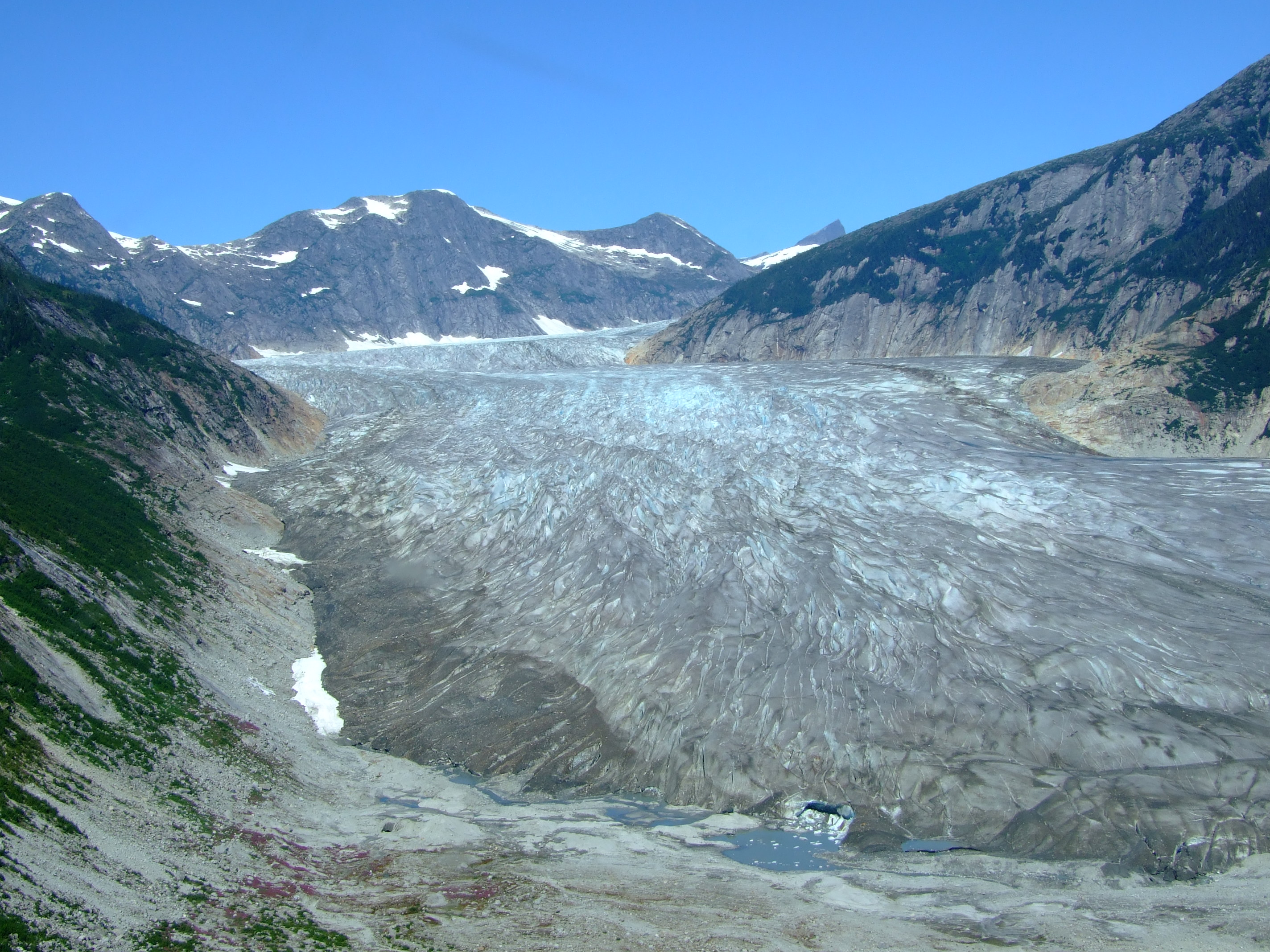 Note the trim line evidencing the rapidly receding size of the Norris Glacier.