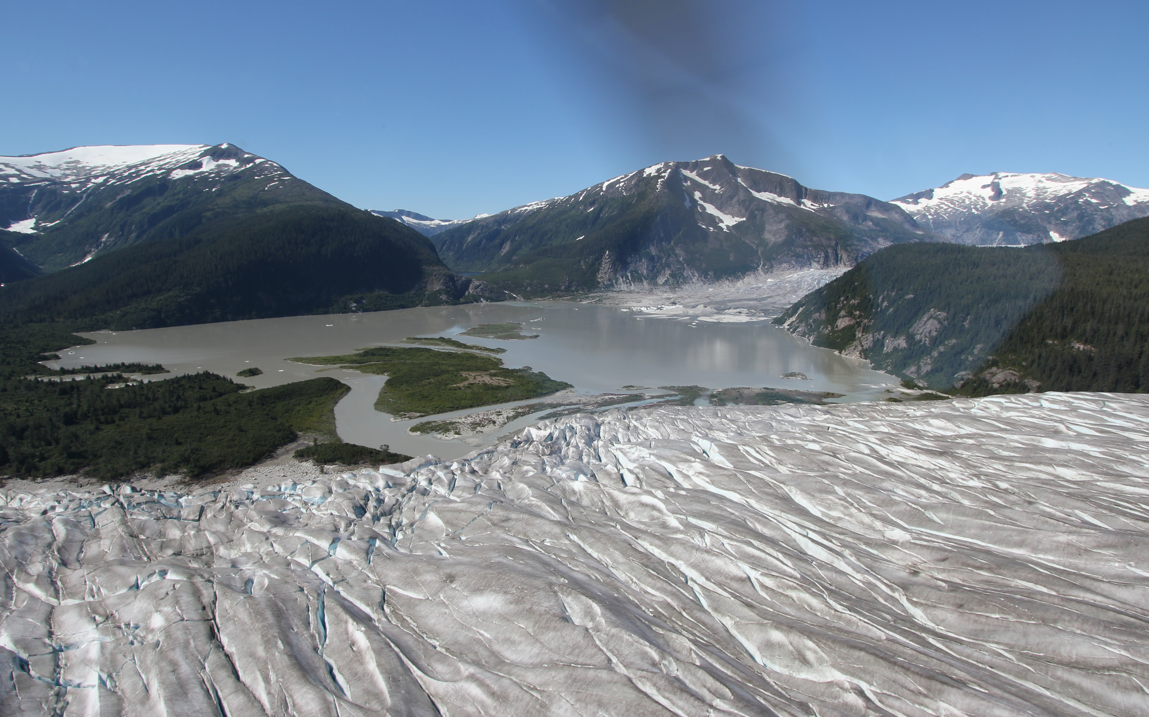 The view looking south-west from the edge of Taku Glacier over Norris Lake to the retreating Norris Glacier terminus and Glory Lake.