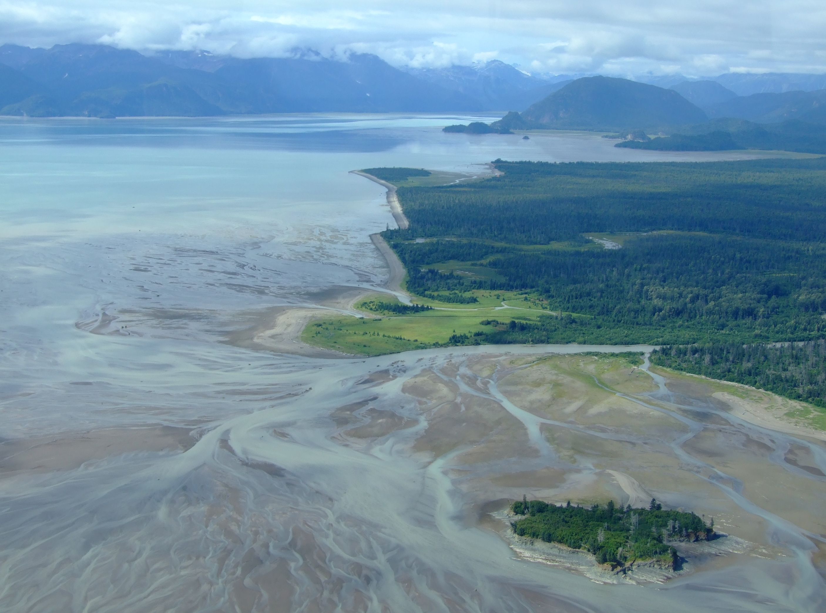 Returning to Cook Inlet as we left the Lake Clark National Park over the mouth of the Crescent River. Beyond the outflow is Tuxedni Bay.
