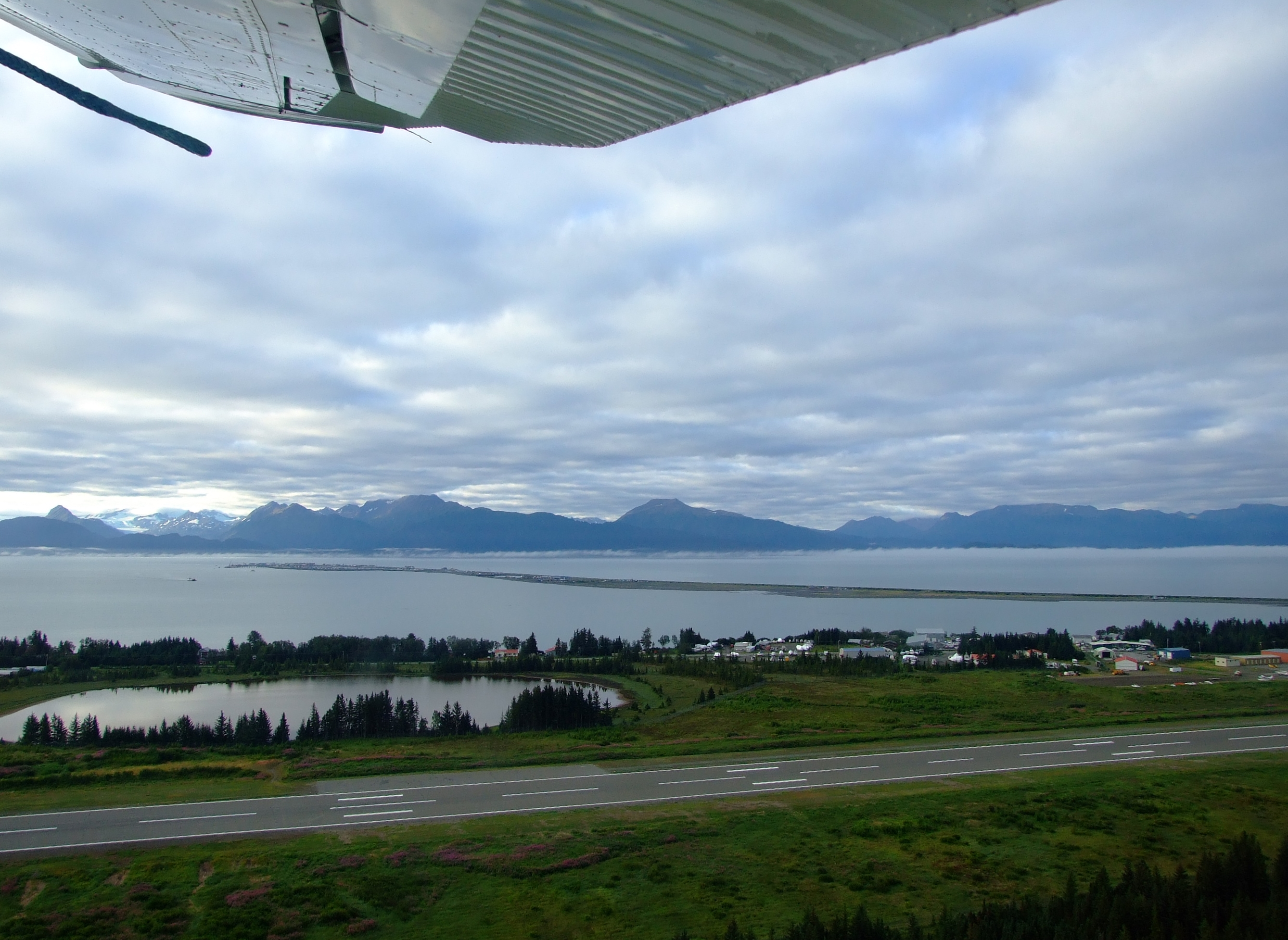 Take off in a north easterly direction from Beluga Lake with a clear view of the line of Homer Spit. At the top end of the Beluga Wetlands Complex is the Homer Airport Critical Habitat Area which can be visited on foot.