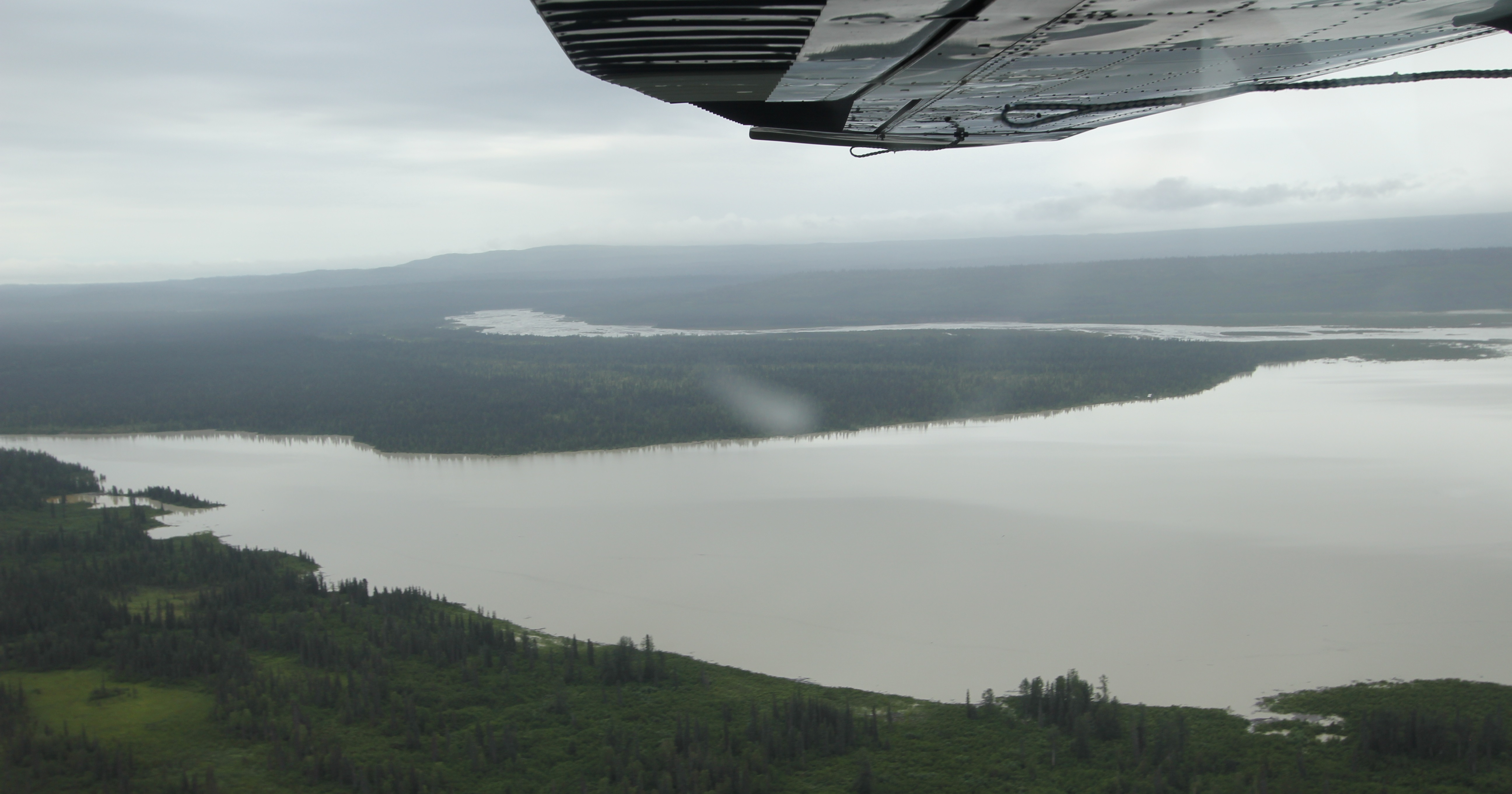 Heading west, looking south. Beluga Lake with the start of the Beluga Rover to the left, with the Chichantna River flowing left to right in the background.]