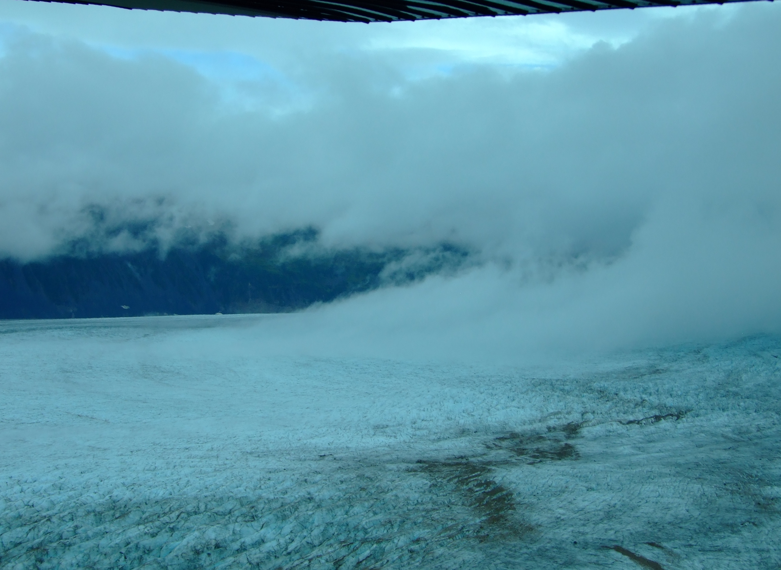 With buffeting winds propelling the cloud down the glacier it was time to get out.
