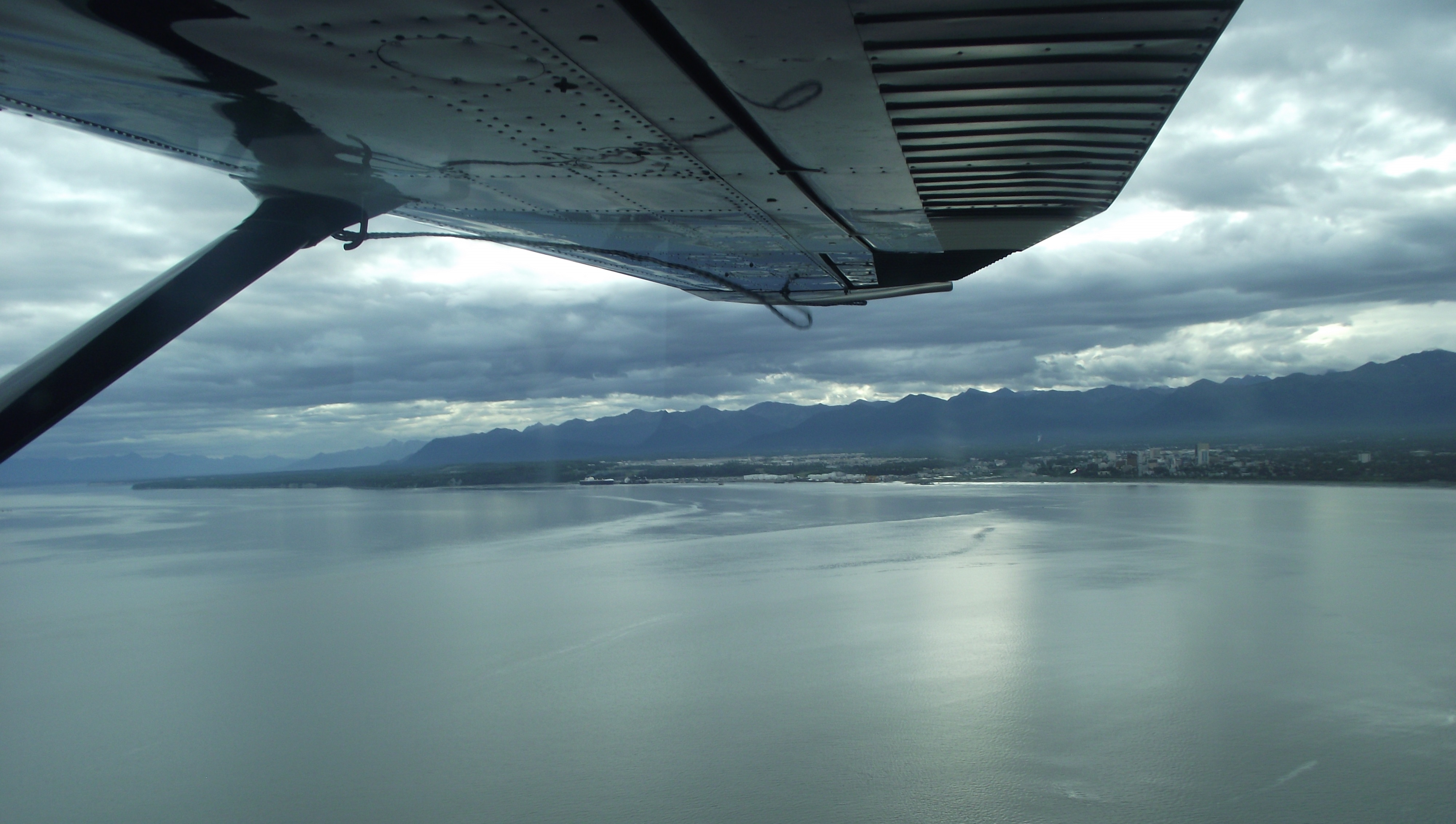 Leaving Anchorage and its Chugach Mountains backdrop, heading across Cook Inlet.