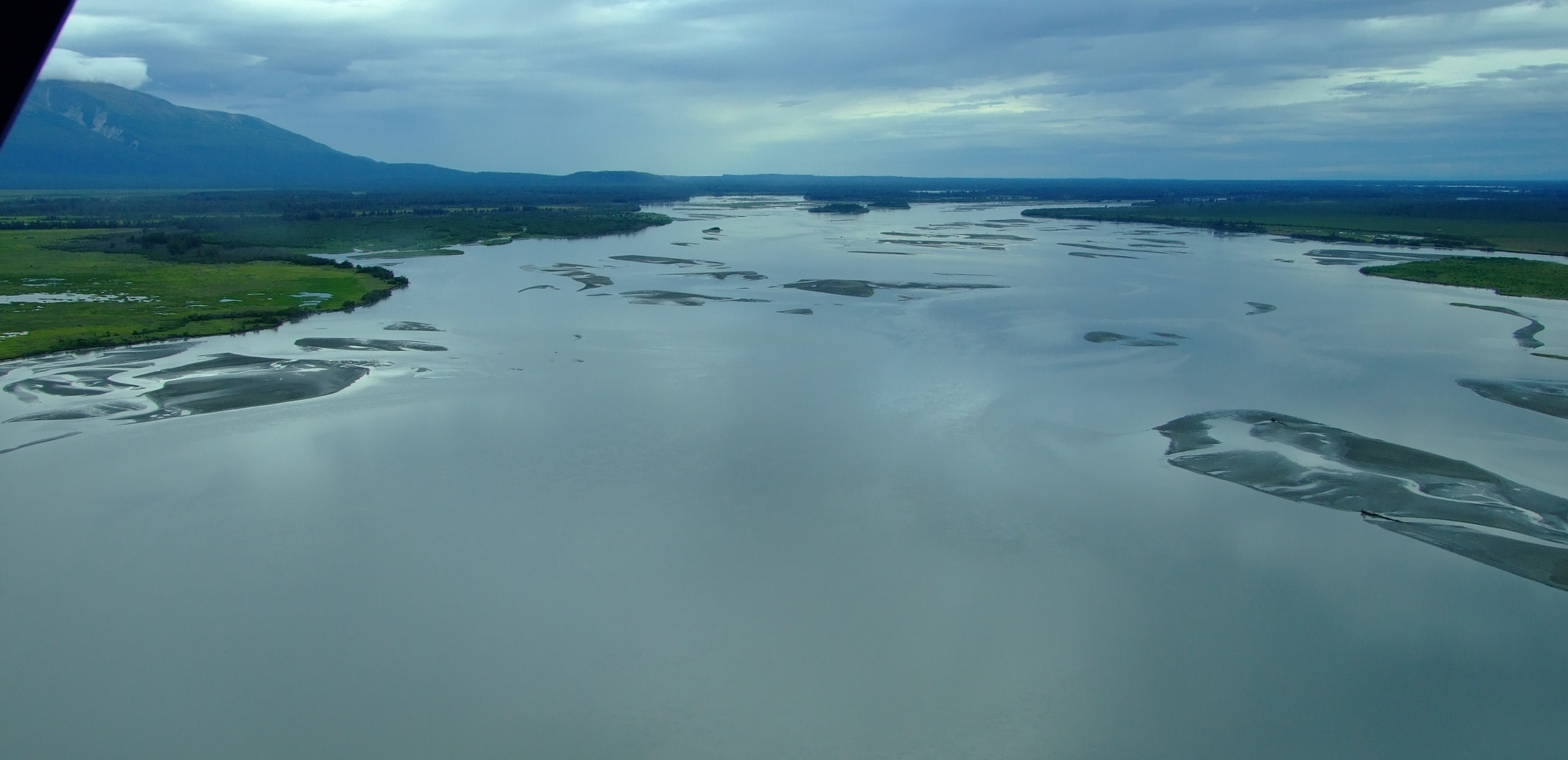 Looking upstream from the outflow of the mighty Susitna River as we continued flying west.