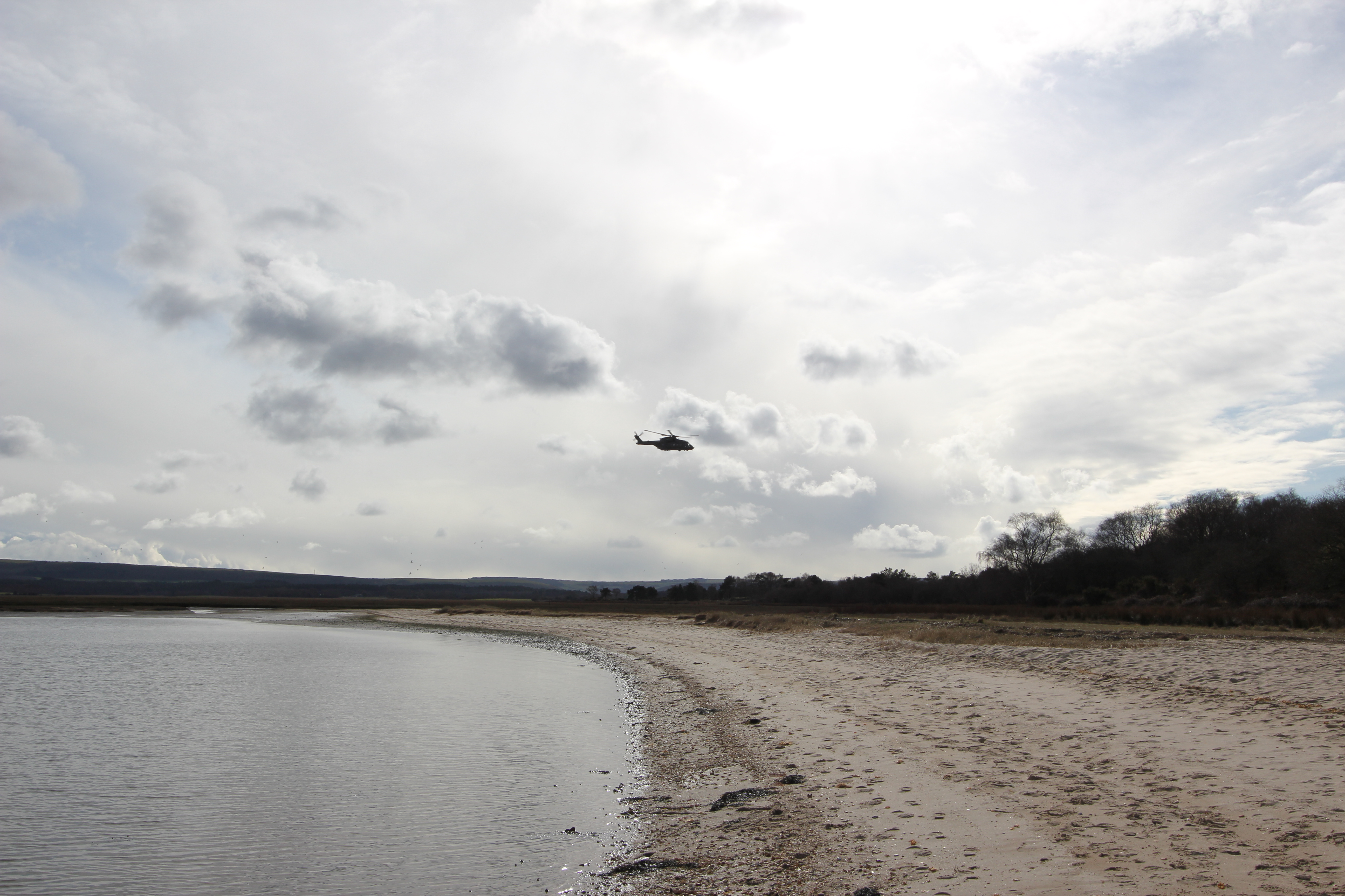 An AugustaWestland Merlin Mk 3 (or Mk 3i), near the southern spit at Shipstal in March 2016. This helicopter is probably from 846 Naval Air Squadron (NAS), as the primary customer for the Commando Helicopter Force (CHF) is The Royal Marines.